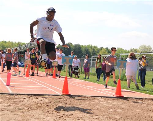 CiTi student Jason Harris gets some distance in the long jump competition.