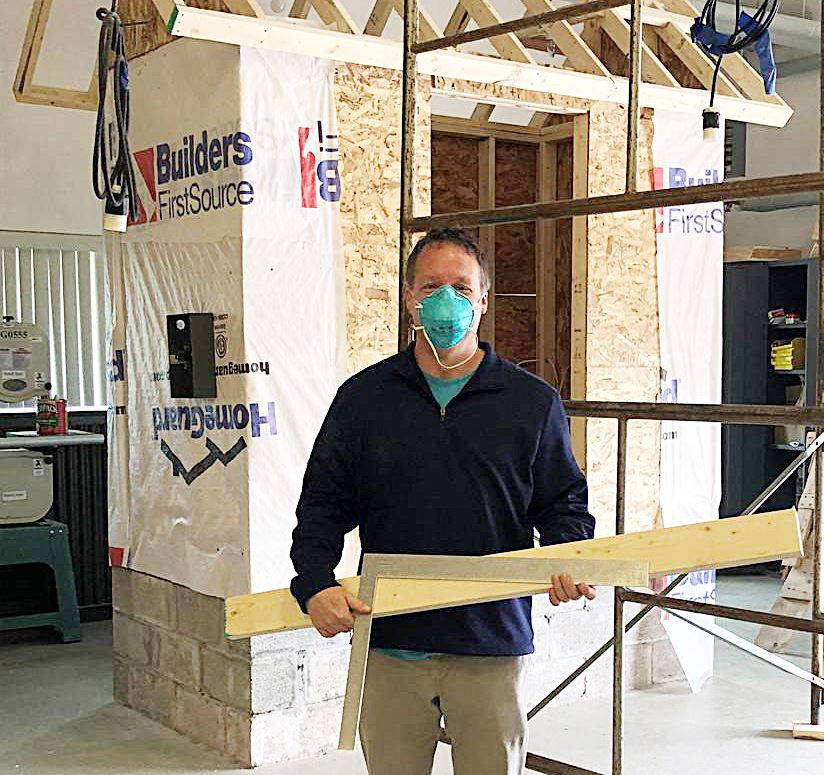Pictured is CiTi Construction Technology instructor Craig Mahon with a carpenter squares and lumber