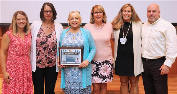 OWI winner Cheryl Beck is pictured along with OCSD admins and officials from OWI.