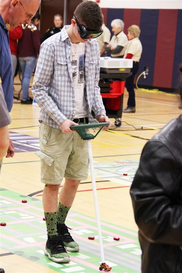 a student navigates a driving course while wearing intoxication goggles